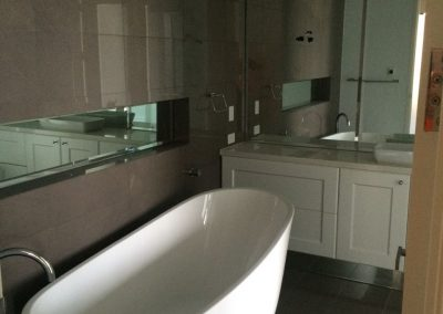 CabTech joinery installers working on-site in this Broadview client's bathroom