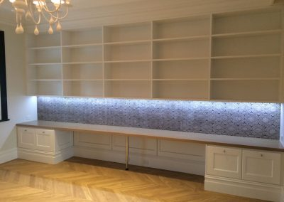 Fancy a living room with ample space to showcase all your precious artefacts - CabTech to the rescue! We designed this enormous wall cabinet for one of our clients in Northgate to display their massive book collection